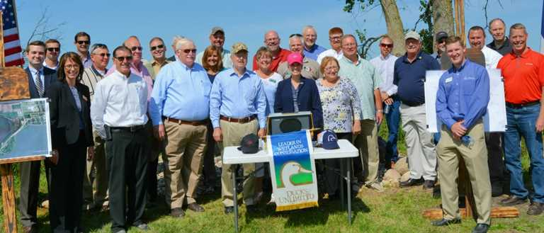DU volunteers and guests tour Little Storm Lake project with Iowa Governor Branstad and Senator Ernst.