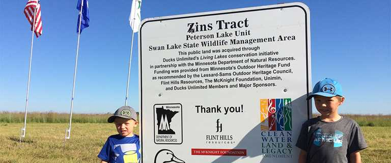 Guests celebrate in July the acquisition of 70 acres on Swan Lake State Wildlife Management Area in Nicollet County.