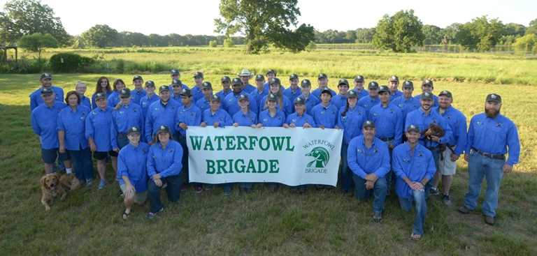 A group of councilors and campers from the Waterfowl Brigade camp.