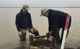 Ryan and Mike Sullivan pulling boards and draining fields after completing the waterfowl flooding practices for the RCPP.