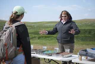 DU communications biologist Jennifer Kross explains the importance of wetlands using handmade dioramas.