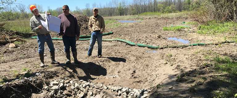 Ducks Unlimited engineers and contractors review conservation plans on Jim Zaepfel's New York property.