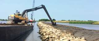 This breakwater will stabilize the shoreline along Freshwater Bayou and promote marsh growth.