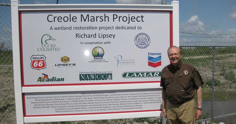 Richard Lipsey with the new project sign.