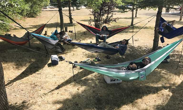 Ducks Unlimited research technicians resting in their hammocks in the middle of a long work day