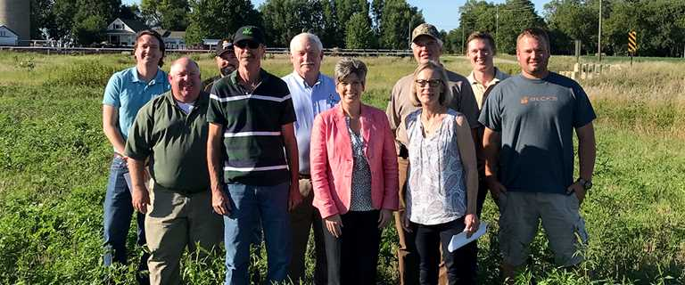 Sen. Joni Ernst (center) toured family farms in August to highlight the importance of conservation to Iowa's farmers and ranchers.