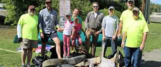 Ducks Unlimited volunteers show off their haul of trash from the 25th Annual French Creek Cleanup.