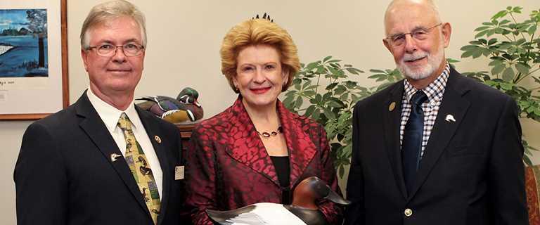 DU Michigan Chairman Dale Borske, Michigan Sen. Debbie Stabenow and DU Michigan Policy Chairman Steve Wyckoff on Dec. 5 in Washington, D.C.