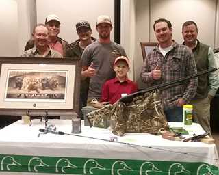Pack Forster (center)  wins gun, print with help from his new friends