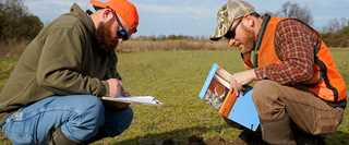 Ducks Unlimited Biologists Jake McPherson, left, and Jim Feaga research the coastal wetlands in central Delaware.