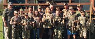 Ten youth participated in the2017 hunt hosted by Ron Bartels (far left), Mark Callais (far right), and others at the south Louisiana club.