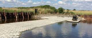 The completed Lake Street Weir, armored with concrete matting, will maintain natural hydrology to 500 acres of tidal wetlands.