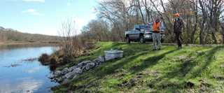 Rhode Island Department of Environmental Management staff inspect enhanced infrastructure at Great Swamp Management Area.