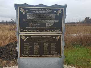 Cairn honoring the eight families who provided the seed money to acquire public grants to restore Neosho habitat.