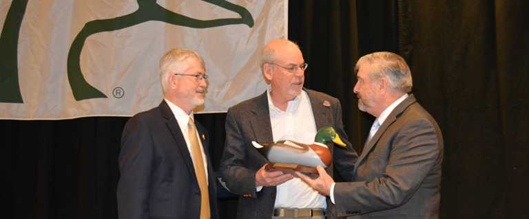 DU CEO/President Dale Hall (right) presents award to Jim Stutzman (center) with Nick Wiley, chief conservation officer.