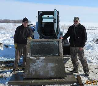 Facilities Manager Chuck Darling (left) and Professional Surveyor Tom Eckroth stand with relocated cairn.