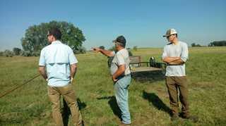 Ducks Unlimited intern William Palarski (right) discusses DU conservation programs with a North Dakota farmer