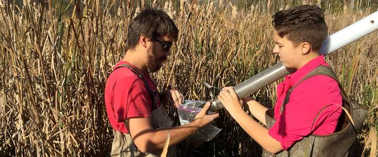 State University of New York students sample wetlands as part of Ed Farley