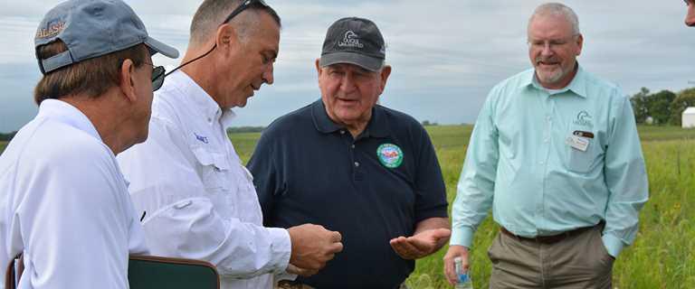 U.S. Agriculture Secretary Sonny Perdue, center, toured several Farm Bill sites in Iowa.