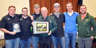 University of Nebraska Lincoln DU chapter honors Dan Kreitman (center) who sends six UNL students to DU national event each year.