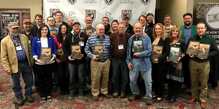 Top chapters from the Minneapolis Metro Area, with Regional Director John Marks.