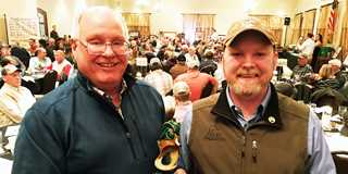 Randy Stutheit (left) from NGPC receives DU wetland manager award from John Denton