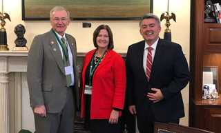 DU Volunteer Mikk Anderson, GPR Director of Public Policy Carmen Miller, and Senator Cory Gardner