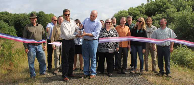 DU Western Region Director Mark Biddlecomb (4th from left) celebrates the purchase of 1100 acres in Washington