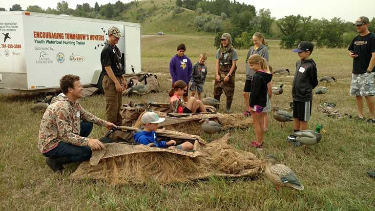 Children learn about duck hunting gear at the youth waterfowl hunting workshop in Bismarck.