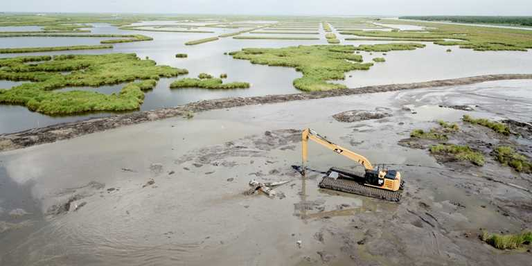 The marsh creation project adds to the terracing project (in background) DU already completed along the protection levee.