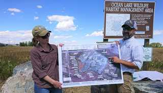 Wyoming Manager of Conservation Martin Grenier (right) and biologist Noelle Smith at the Ocean Lake project dedication.