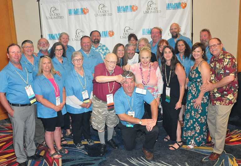 Montana volunteers at the 2019 DU National Convention celebrate their $1 million goal.