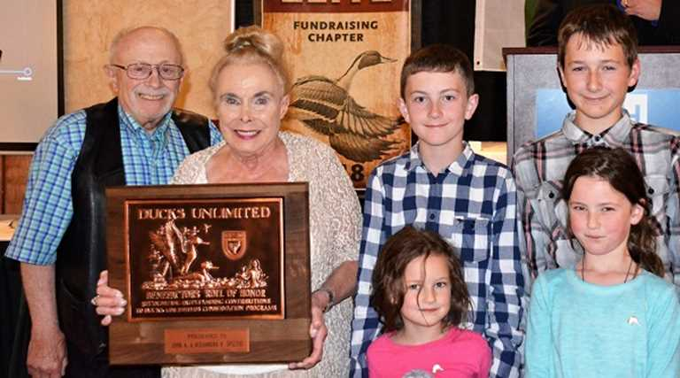 John and Alex with their great grandchildren accepting their Benefactor level plaque.