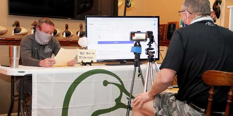 Dave Eller works the camera as Chad Hohenwarter talks to an online event audience April 18.