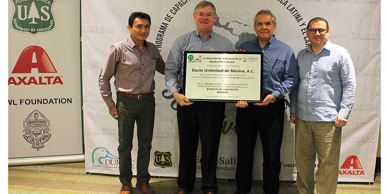 René Kantun, director of the Celestun Biosphere Reserve, DUMAC President Bill Ansell, DUMAC CEO Eduardo Carrera, and Daniel Salcido.