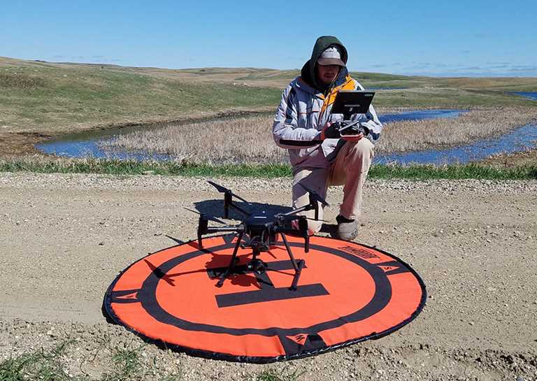 UND student Mason Ryckman studies the use of unmanned aerial vehicles in waterfowl research.