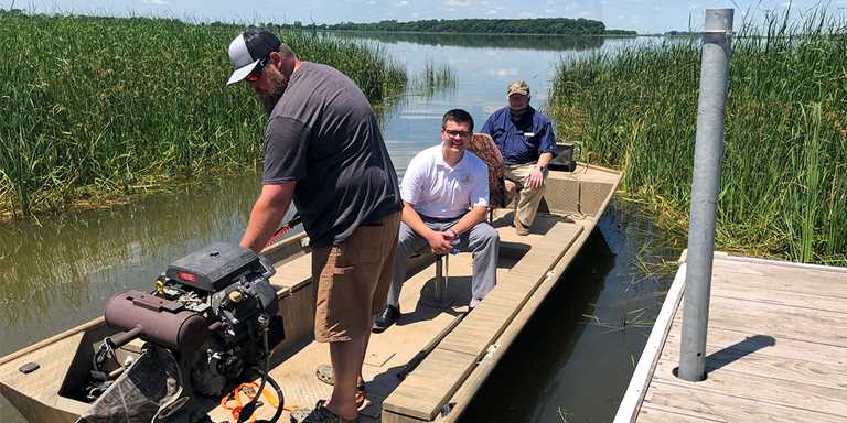 From left: Egan Mattson, Aaron Eberhart and Bill Aldinger prepare to tour Freeborn Lake on June 27.