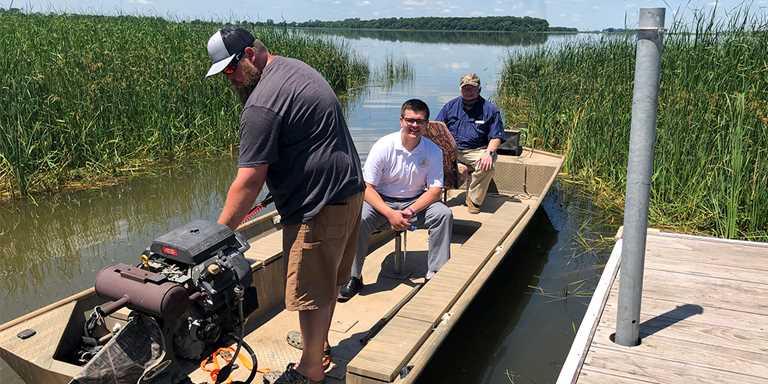 From left: Egan Mattson, Aaron Eberhart and Bill Aldinger prepare to tour Freeborn Lake on June 27.