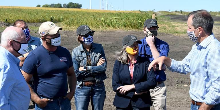 L-R: USDA Sec. Perude, landowner Heath Stolee, Gov. Reynolds, Sen. Ernst, DU CEO Adam Putnam, Iowa Agriculture Sec. Mike Naig.