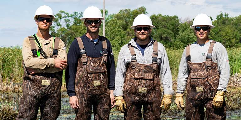Cass County Electric Cooperative lineworkers (from left) Brett Dolan, Phil Lamb, Justin Gronbeck and Cole Leir chose DU Itasca waders