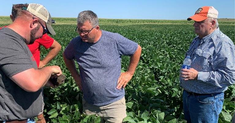 DU Agronomist Brian Chatham discusses soil health conditions with a local landowner and DU Major Sponsor in Perpetuity Larry Ness.