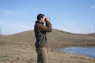 Tanner Gue, DU bioloigst scans wetlands for nesting waterfowl as part of a study being conducted in North Dakota